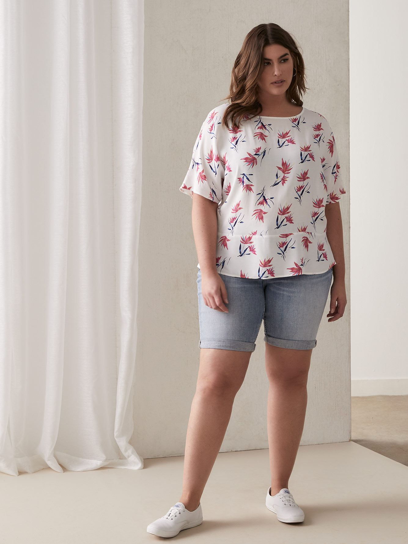 Extended-Sleeve Floral Blouse with Button-Up Back
